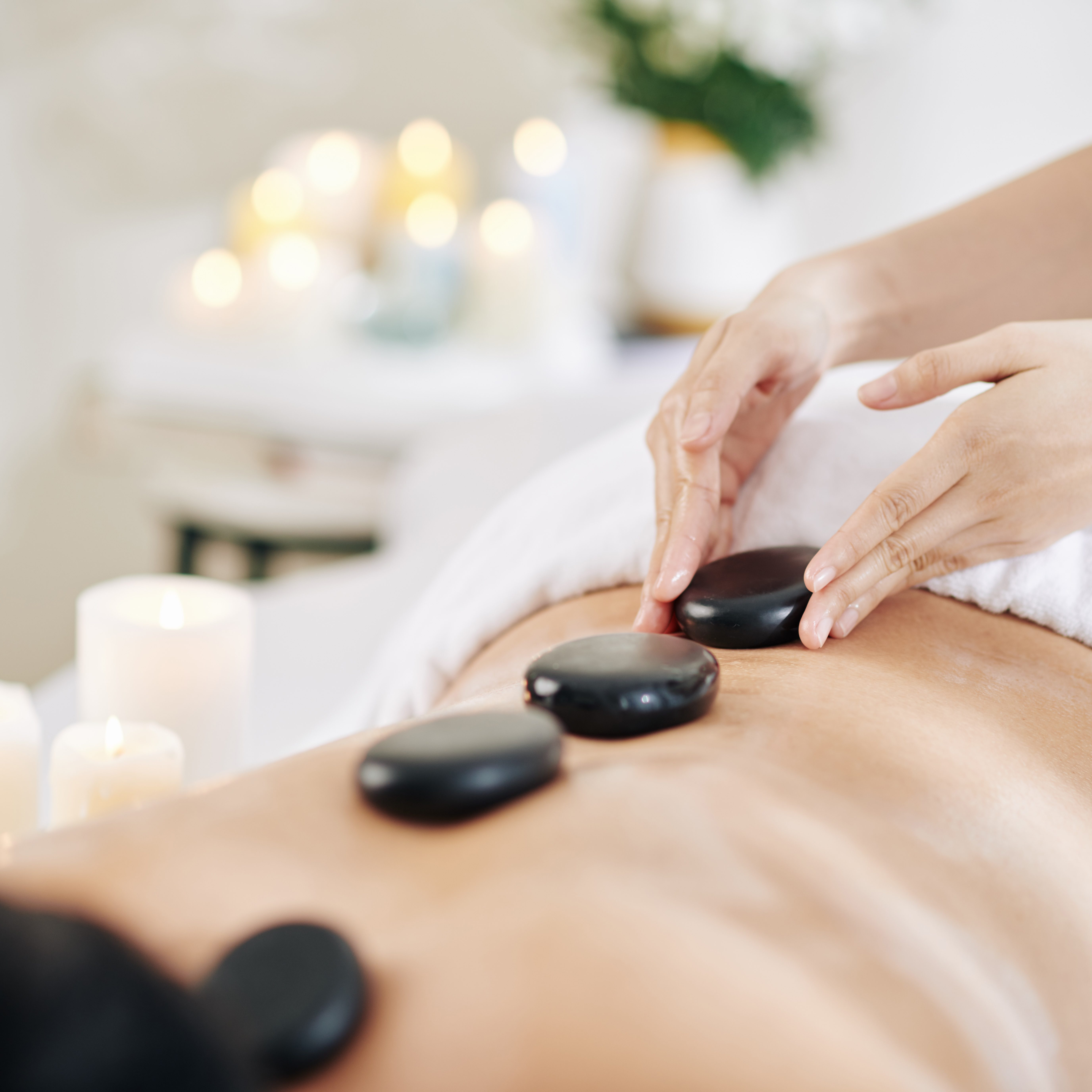 Spa salon client getting lastone therapy with warm basalt stones